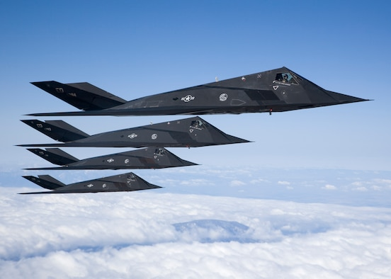 EDWARDS AIR FORCE BASE, Calif. -- Four F-117 Nighthawks fly in formation during a sortie over the Antelope Valley recently. After 25 years of history, the aircraft is set to retire soon. As the Air Force's first stealth fighter, the F-117 is capable of performing reconnaissance missions and bombing critical targets, all without the enemy's knowledge. (Photo by Bobbi Zapka)