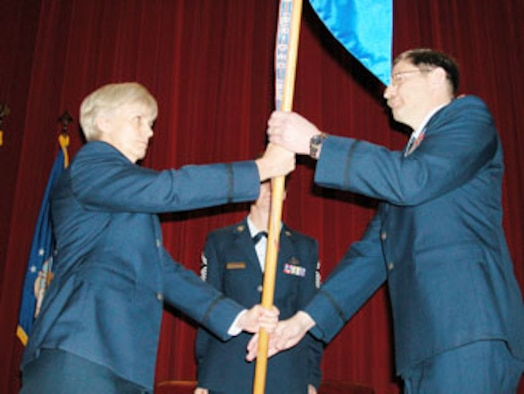 Col. Pamela LeBlanc, 452nd Mission Support Group commander at March Air Reserve Base, left, accepts the guidon from incoming 50th Aerial Port Squadron commander, Major Jody W. Chalich, on April 15.  Major Mary Van Scyoc, outgoing commander of the 50th APS, delivered her goodby to the audience at the change of command ceremony. (U.S. Air Force photo by Tech. Sgt. Michael Blair, 452 AMW)