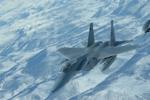 EIELSON AIR FORCE BASE, Alaska -- An F-15 Strike Eagle, 60th Fighter Squadron, Eglin AFB, Florida, breaks away after receiving fuel from a KC-10 extender over the Pacific Alaska Range Complex on April 18 during Red Flag-Alaska 07-1. Red Flag-Alaska is a Pacific Air Forces-directed field training exercise for U.S. forces flown under simulated air combat conditions. It is conducted on the Pacific Alaskan Range Complex with air operations flown out of Eielson and Elmendorf Air Force Bases. (U.S. Air Force Photo by Airman 1st Class Jonathan Snyder)