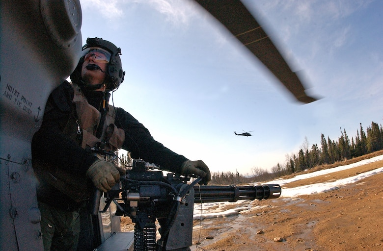 EIELSON AIR FORCE BASE, Alaska--Staff Sgt. Dave Torrance, 210th Rescue Squadron Detachment 1 flight engineer, scans the area for enemy threats while manning a 7.62mm minigun during a combat search and training mission at Red Flag-Alaska 07-1 April 17. (U.S. Air Force photo by Senior Airman Justin Weaver).