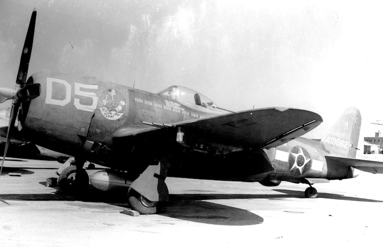"1º GAC P-47s carried the ""Senta a Pua!"" emblem as nose art along with the national insignia of Brazil. (U.S. Air Force photo)"