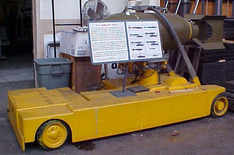 The K-3 bomb lift truck was designed for use with the Convair B-36 bomber. Because of the bomber's mammoth size, the B-36's top bomb shackles were more than 17 feet from the ground. Hand-cranked hoist and cable loading of the large bombs was too hazardous, so the Air Force ordered a self-powered weapons loader. (U.S. Air Force photo)