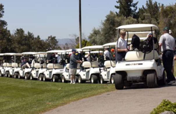The convoy of golf carts are ready to take off with Colonels Pamela, 452nd Mission Support Group commander, and Cam, 452nd Maintenance Group commander, LeBlanc leading the way. March Air Reserve Base captured the winner's trophy at Broken Shaft Golf tournament against the Greater Riverside Chambers of Commerce. The Broken Shaft Tournament is an annual event between the two teams and this year, 52 people participated.  The base ended eight strokes ahead taking the low net total with 1903.  (U.S. Air Force photo by Staff Sgt. Amy Abbott, 452 AMW)