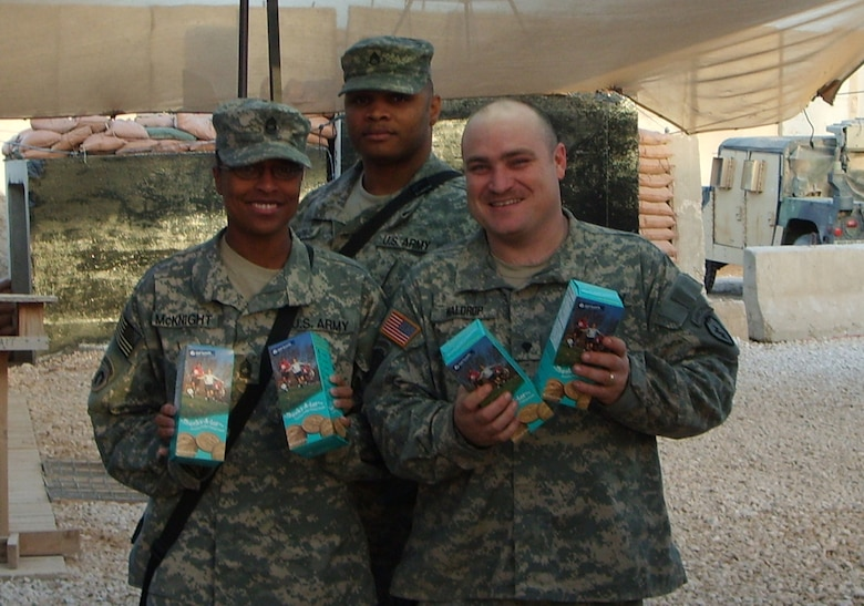 SOUTHWEST ASIA --  Soldiers deployed here show their boxes of Girl Scout cookies.  Brownies and Junior Girl Scouts at Osan Air Base sent 636 boxes of Girl Scout cookies to servicemembers in Iraq and Afghanistan thanks to the donations from Team Osan. (Courtesy photo)