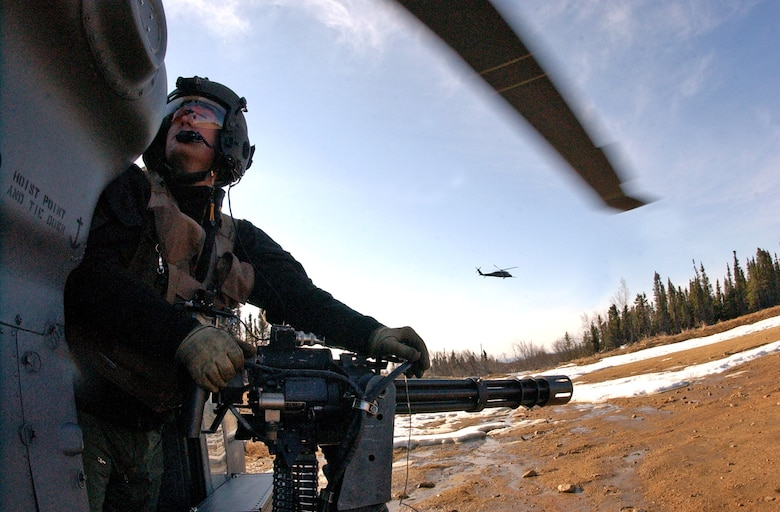Staff Sgt. Dave Torrance scans the area for enemy threats aboard an HH-60G Pave Hawk helicopter April 17 while manning a 7.62mm minigun at Eielson Air Force Base, Alaska. Red Flag-Alaska exercises help enhance combat training for U.S. military and coalition forces. Sergeant Torrance is a 210th Rescue Squadron Det. 1 flight engineer. (U.S. Air Force photo/Senior Airman Justin Weaver)