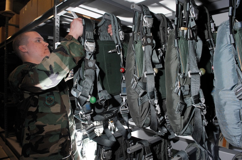 MCCHORD AIR FORCE BASE, Wash. -- Airman Steven Sontag, 62nd Operations Support Squadron, removes a parachute from the aircrew life support section warehouse April 16, 2007 in preparation for inspection and pre-positioning aboard the aircraft. (U.S. Air Force photo/Abner Guzman)