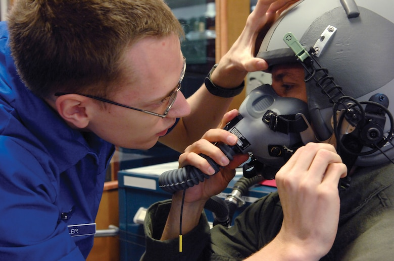MCCHORD AIR FORCE BASE, Wash. -- Captain Branin Klausman,7th Airlift Squadron, right, sits patiently April 16, 2007 as Airman 1st Class Anthony Tyler, 62nd Operations Support Squadron, performs a fit test to ensure the mask is free from defects and leaks  at the aircrew life support section warehouse. (U.S. Air Force photo/Abner Guzman)