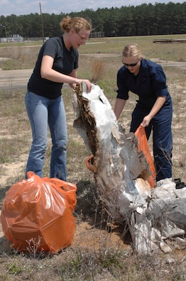 "SHAW AIR FORCE BASE, S.C. -- Senior Airman Cassidy Eby (Left) and Staff Sgt Jessica Feil, 20th Civil Engineer Squadron Readiness Flight, pick up trash as part of Earth Day activities April 20. The base-wide Earth Day program, ""Keep Shaw AFB Clean,"" raised environmental concerns to encourage cleaner daily practices. Events included a base-wide cleanup, an electronic waste turn-in and an Arbor Day tree planting ceremony. (U.S. Air Force photo by Tech. Sgt. Keri Whitehead)"