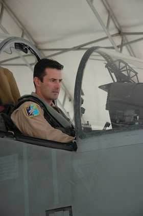 British Royal Air Force Squadron Leader Michael Baker, pilot, Marine Attack Squadron 513, sits in the cockpit of an AV-8B Harrier on the flightline here. The Harrier is a highly adaptable aircraft and used by many nations.