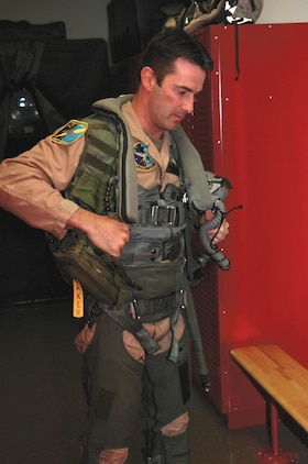 British Royal Air Force Squadron Leader Michael Baker suit suits up in his flight suit at Marine Attack Squadron 513?s hangar here Monday. Baker, a pilot for VMA-513, is part of the pilot exchange program in which, a pilot spends two or three years stationed with a different country to learn their methods and tactics.