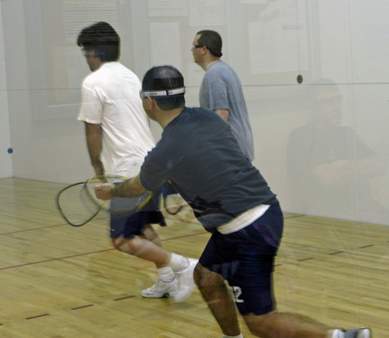 From left to right: Jerry Padilla, 90th Civil Engineering Squadron, Maj. Mike Emerson, 30th Airlift Squadron, and Senior Airman Jason Hanna, 90th CES, play doubles racquetball in the intramural racquetball championship April 6 in Freedom Hall. The 30th AS #1 team took first place after winning three games against the 90th CES and the 90th Medical Operations Squadron teams (Photo by 2nd Lt. Lisa Meiman).