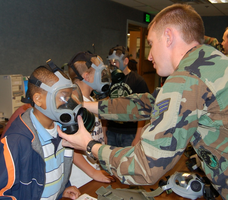 Attendees of Kid's Deployment Day had the chance to try gas masks, cold weather gear and other things their military parents use on deployments. Photos by Beth Young