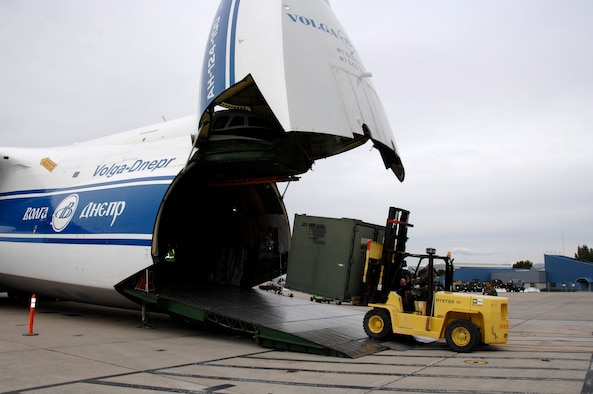 Airmen from the 129th Rescue Wing load cargo onto a Russian Volga-Dnepr AN-124 long-range heavy transport aircraft April 21 at Moffett Federal Airfield, Calif. The contracted AN-124 transported 129th Rescue Wing deployment cargo to Afghanistan because the high operations tempos of Operations Iraqi Freedom and Enduring Freedom have kept C-17 Globemaster III and C-5 Galaxy aircraft fully engaged. (U.S. Air Force photo/Master Sgt. Daniel Kacir)