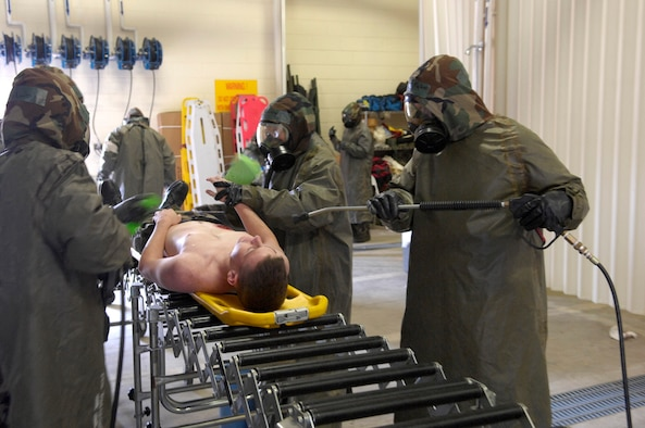 KUNSAN AB, Republic of Korea -- Medics from the 8th Medical Group use the proper procedures to decontaminate a patient with simulated injuries during an inspection here April 18.  The 8th Fighter Wing is currently undergoing an operational readiness inspection to test its ability to conduct its wartime mission. (U.S. Air Force Photo by Master Sgt Jack Braden.)