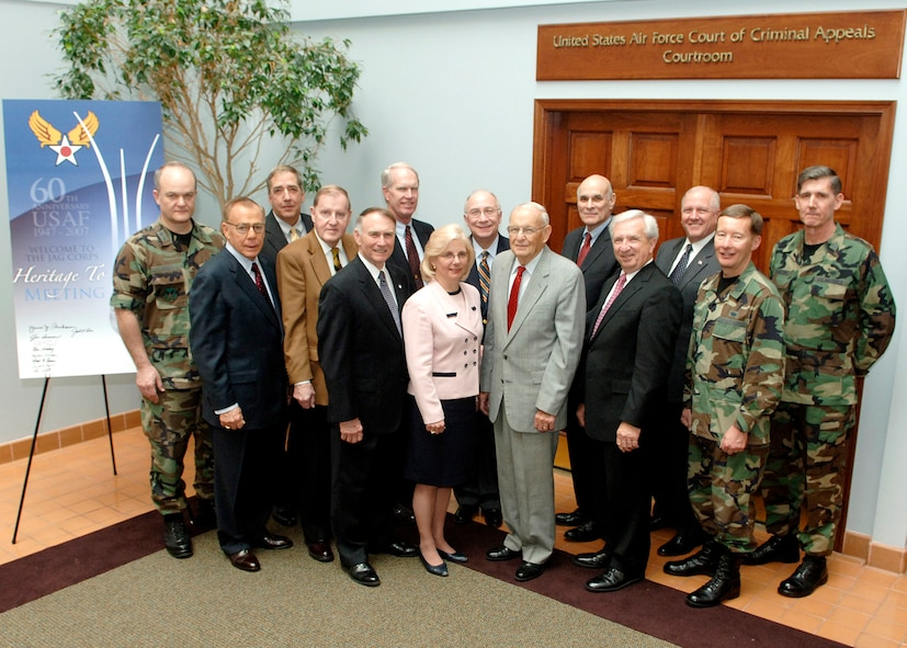 "Maj. Gen. Jack L. Rives (left), the Air Force Judge Advocate General, hosted a ""Heritage to Horizon"" meeting recently at Bolling AFB, D.C., along with Maj. Gen. Charles J. Dunlap Jr. (near right), the deputy JAG, and Brig. Gen. Richard C. Harding (far right), selected to command the Air Force Legal Operating Agency at Bolling AFB.  Eleven JAG Corps leaders, all retired general officers or Senior Executive Service civilians, gathered to discuss the way ahead for the corps.  (U.S. Air Force photo/Thomas Dennis)"