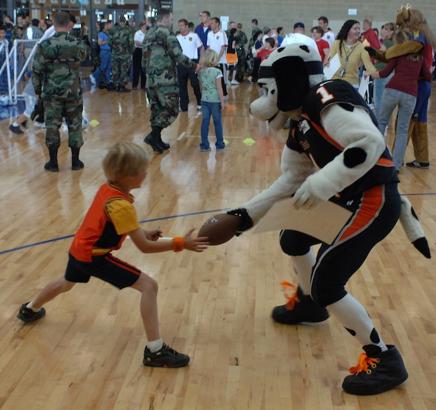 Utah Blaze mascot Chief Blaze plays keep away from a young fan trying to get an autographed football from him during the Salute to Team Hill held at the base fitness center. Photo by Alex R. Lloyd