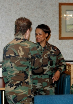 Colonel Renita Alexandar, 28th Bomb Wing Mission Support Group commander, meets one of the many non-commissioned officers that work within her group.  Colonel Alexander and Chief Master Sgt. Jim Urban, 28th Bomb Wing Mission Support Group chief, met with NCOs at the Bandit Inn dining facility on April 25. Colonel Alexander addressed issues such as the new 28th MSG realignment, performance reports, decorations and the role of supervisors.