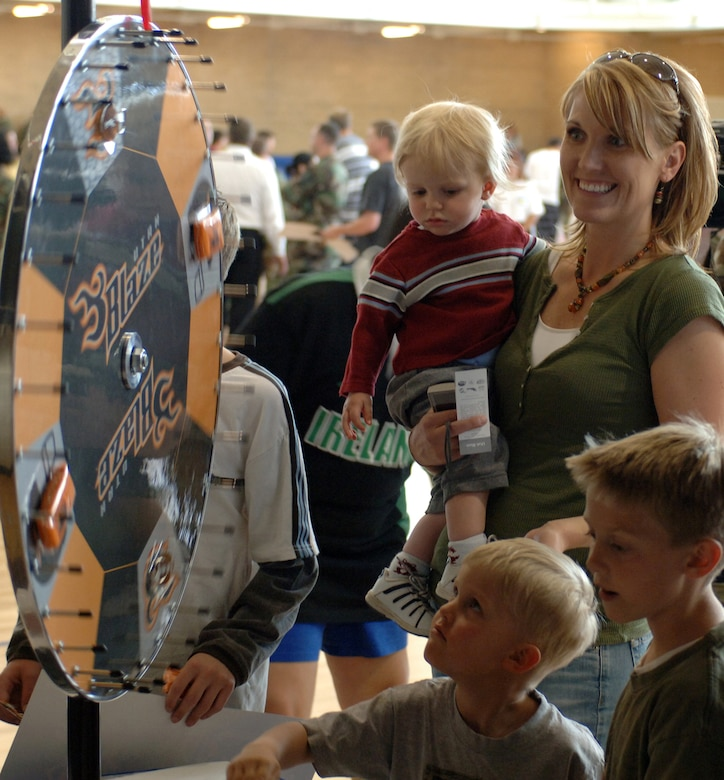 "A Team Hill Family spins the Utah Blaze ""Wheel of Prizes"" during the Salute to Team Hill held at the base fitness center. Photo by Alex R. Lloyd"