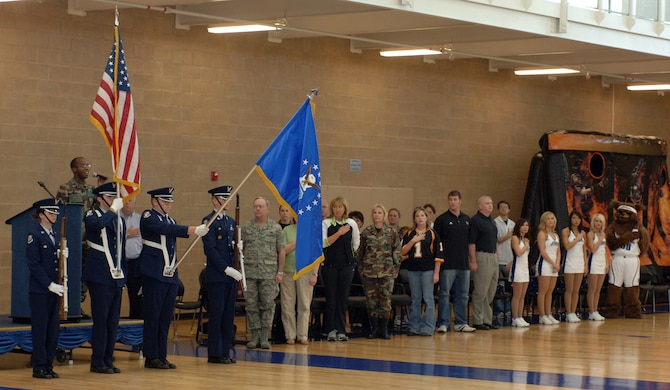 Capt Sean Carter, 75 ABW/PA sings the national anthem while the Northridge High School Jr. ROTC Honor Guard present the flag during the opening of the Salute to Team Hill held at the base fitness center. Photos by Alex R. Lloyd