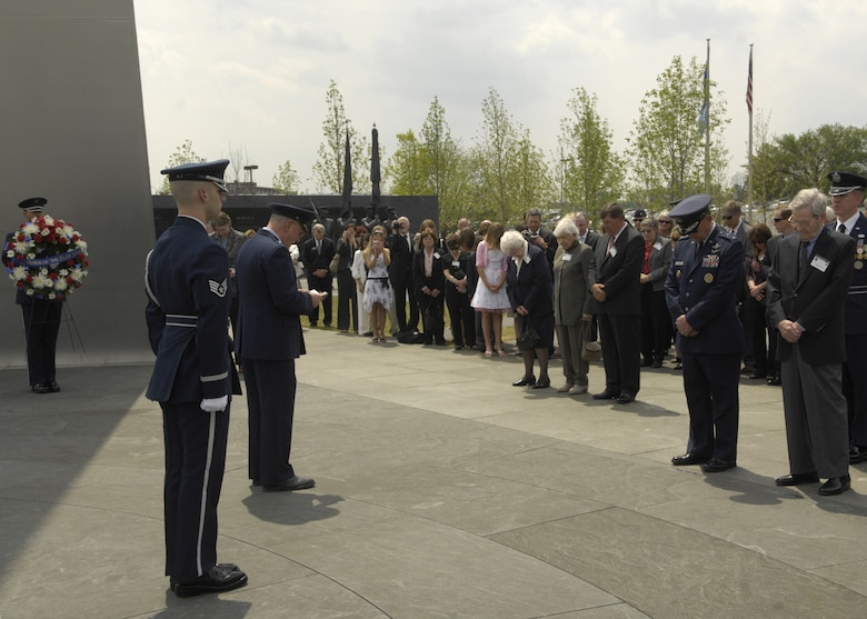 Chaplain (Brig. Gen.) Cecil R. Richardson gives the invocation during a wreath-laying ceremony in honor of the Flak Man crew at the Air Force Memorial, Arlington, Va., April 24. The wreath was placed by Edward McNally, the Bombardier of the B-24 Bomber, The Flak Man, in honor of the former crew members of the Flak Man who dedicated their lives to the cause of freedom. (U.S. Air Force photo by Senior Airman Rusti Caraker)