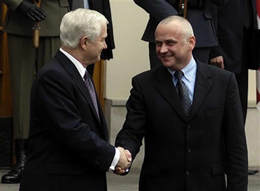 Secretary Gates Shakes Hands With Polish Minister Of Defense