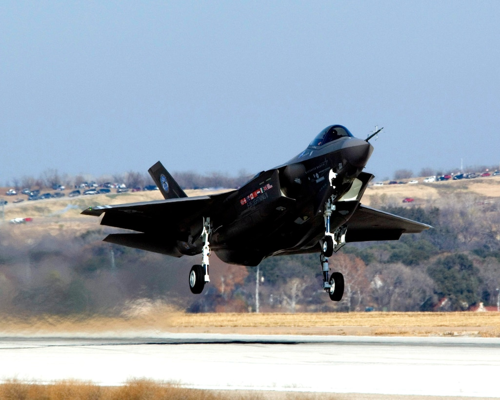 An F-35 Lightning II the Joint Strike Fighter, takes off for its first flight as part of system development testing Dec. 15, 2006, in Fort Worth, Texas. Three variants of the aircraft are being developed for the Air Force, Marine Corps and Navy. (Lockheed Martin photo/Tom Harvey)