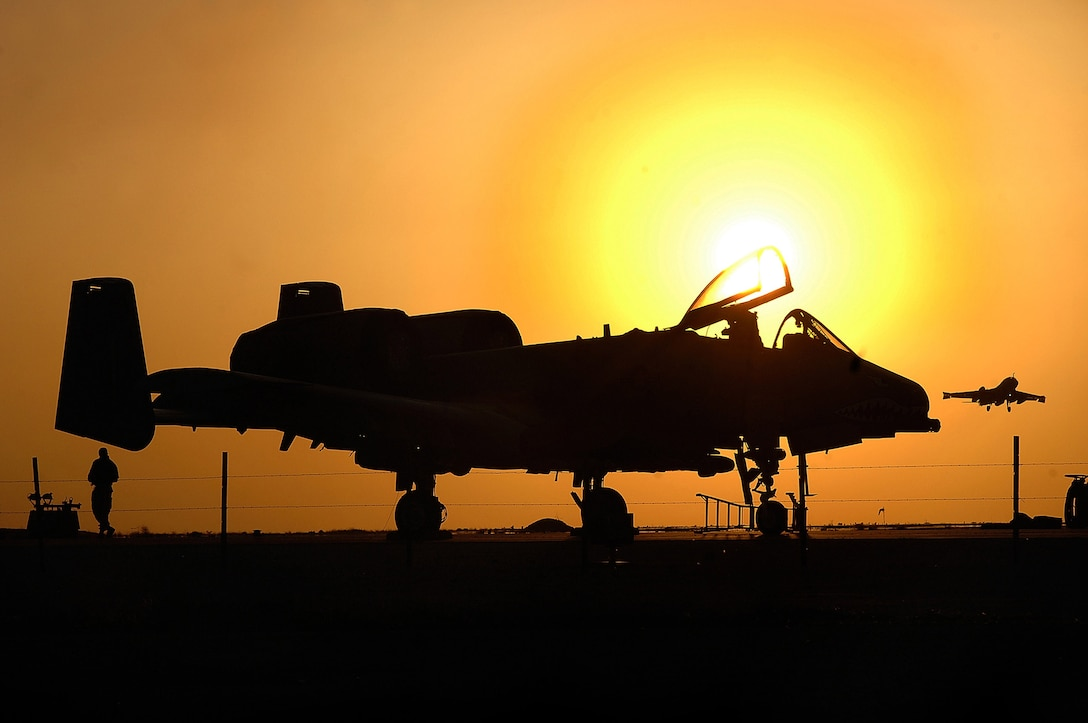 Maintenance crews on the A-10 Thunderbolt II end their 12-hour duty day April 25 at the Al Asad Air Base, Iraq. The 438th Air Expeditionary Group A-10s perform 10 sorties daily providing top cover for ground forces in Iraq, with 900 sorties in this last four months. (U.S. Air Force photo/Tech. Sgt. Cecilio M. Ricardo Jr.)