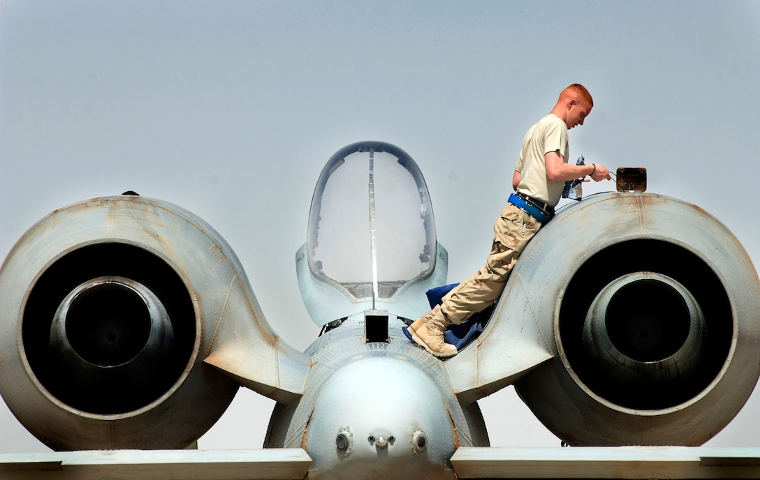 Senior Airman Kevin Crawford performs an intake and exhaust inspection on an A-10 Thunderbolt II April 25 at Al Asad Air Base, Iraq. A-10s provide close-air support to ground troops in Iraq. The 438th Air Expeditionary Group A-10s perform approximately 10 sorties daily. Airman Crawford is assigned to the 438th AEG. His hometown is Boling Brook, Ill. (U.S. Air Force photo/Tech. Sgt. Cecilio M. Ricardo Jr.)