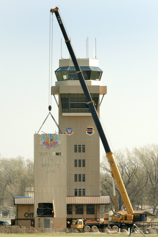 OFFUTT AIR FORCE BASE, Neb. -- A crane prepares to remove a portion of the old air traffic control tower April 21. The remainder of the old tower was dismantled by early afternoon. A ribbon cutting for the new air traffic control tower is scheduled for 11 a.m. May 9. (U.S. Air Force Photo by Josh Plueger)