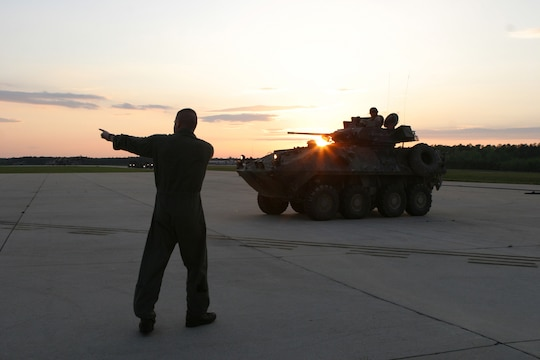 Sgt. Mark Chapman, a loadmaster with Marine Aerial Refueling Transport Squadron 252, directs a Light Armored Vehicle (LAV) away from a Rapid Ground Refueling point at Blackstone Army Air Field, near Fort Pickett, Va., April 28, 2007. The LAV is with Light Armored Reconnaissance Platoon, Weapons Company, Battalion Landing Team, 3rd Battalion, 8th Marine Regiment, 22nd Marine Expeditionary Unit. The Marines and Sailors of BLT 3/8 are scheduled to deploy as the Ground Combat Element of the 22nd Marine Expeditionary Unit later this year. (Official Marine Corps photo by Sgt. Matt Epright)