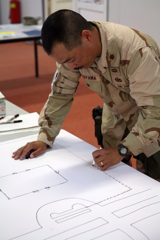 AL ASAD, Iraq - Air Force Maj. Steve Sugiyama, the Antiterrorism Force Protection officer for the International Zone, draws out his vulnerability assessment for the Level II ATFP class held aboard Al Asad, April 29. The class taught ATFP officers how to ensure that the service members in their units remained safe during their deployment.