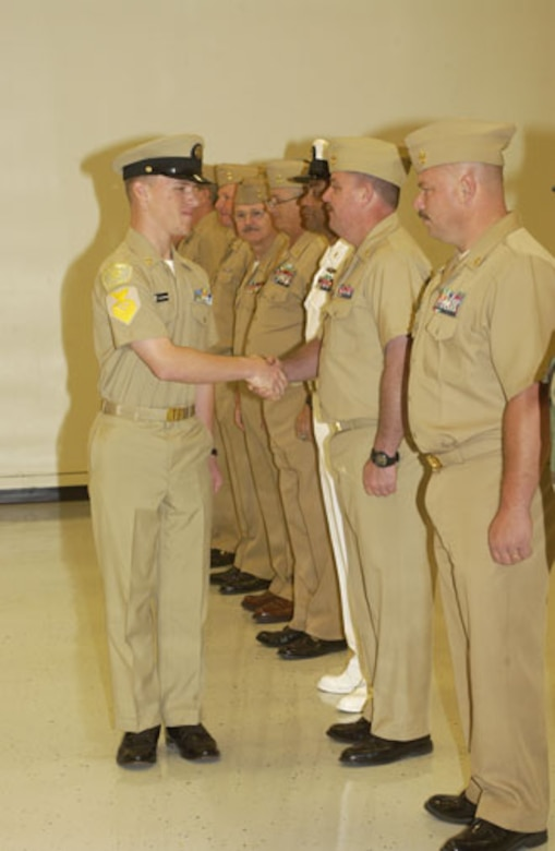 Cody Blackshear shakes hands with various other chief petty officers after being promoted to chief petty officer himself, but within the U.S. Naval Sea Cadet Corps.