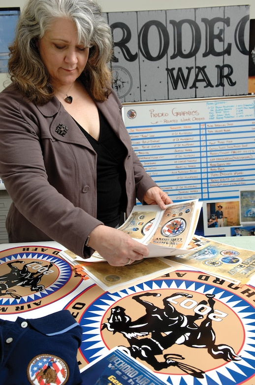 MCCHORD AIR FORCE BASE, Wash. -- Lead designer Adamarie Lewis-Page, 62nd Communications Squadron, categorizes ceremonial programs, brochures and logos designed specifically for Air Mobility Command's Rodeo 2007 in the base multimedia office April 24, 2007. (U.S. Air Force Photo By Abner Guzman)