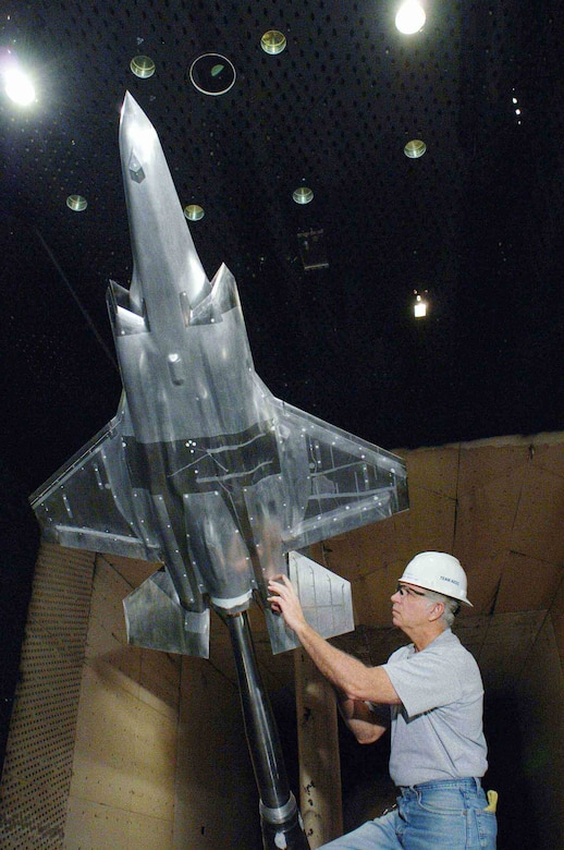 J.D. Roberts, a Lockheed Martin engineer, inspects the JSF model during a break in aerodynamics load testing in the Propulsion Wind Tunnel's 16-foot transonic wind tunnel at Arnold Engineering Development Center.