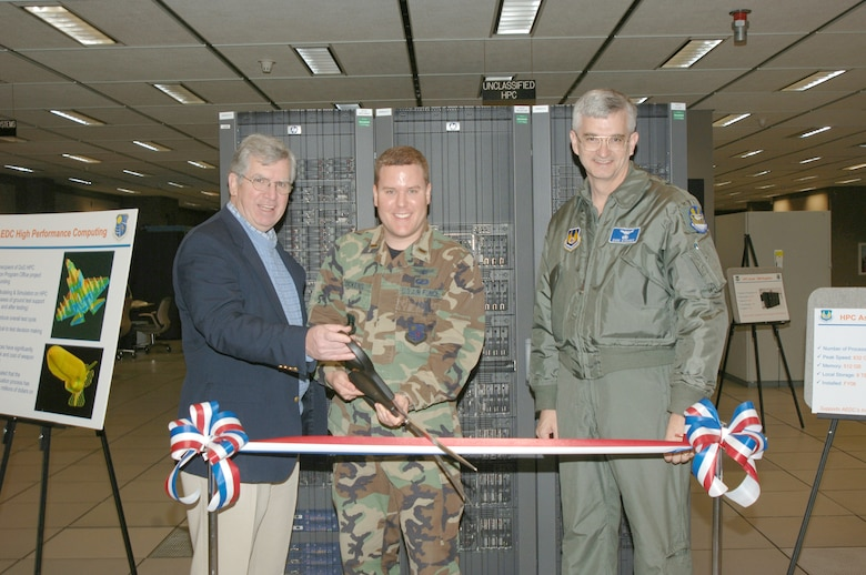 From left to right Dr. Edward Kraft, center technical advisor, 2nd Lt. Rickey Dickens, project manager for the high performance computing maintenance project and Center Commander Brig. Gen. David L. Stringer cut the ribbon for the new high performance system.
