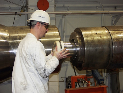 David Brown, an ATA outside machinist, loads a high fidelity projectile into the barrel of a two-stage gas gun at the center's Hypervelocity Ballistic G-Range during recent ongoing high-velocity impact testing.