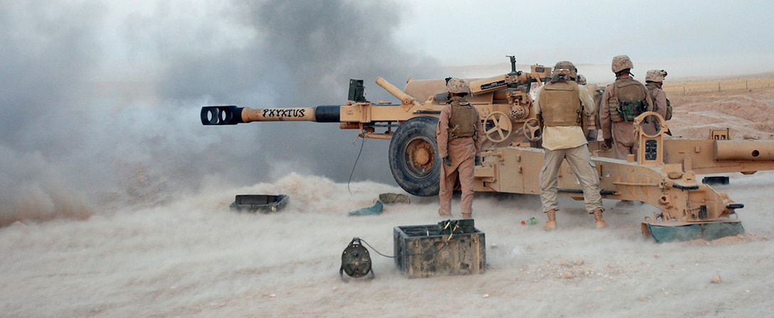 COMBAT OUTPOST RAWAH, IRAQ – Marines with Battery R, 5th Battalion, 11th Marine Regiment, attached to Task Force Highlander, Regimental Combat Team 2, man Phyxius, an M198 Howitzer artillery cannon, during a direct-fire training mission. Phyxius is known in Greek mythology as the god of flight. Official Marine Corps Photo By Cpl. Ryan C. Heiser.