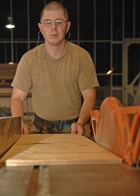 Staff Sgt Roy Goldstein, 4th Logistics Readiness Squadron, Seymour Johnson AFB, Goldsboro, North Carolina prepares to use a radial arm saw to cut wood used to make pallets on 1 August 2007.(U.S. Air Force photo by Senior Airman Jessica Klingler)