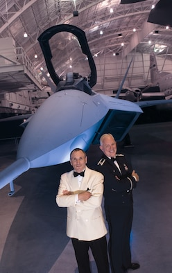 DAYTON, Ohio - U.S. Air Force Band of Flight Commander/Conductor Lt. Col. Alan Sierichs and Dayton Philharmonic Orchestra Music Director Neal Gittleman stand in front of the YF-22 at the National Museum of the U.S. Air Force. (Photo courtesy of Dayton Philharmonic Orchestra)