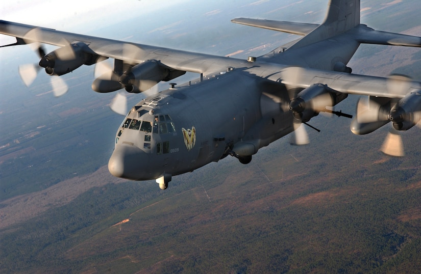 """AC-130U """"Spooky"""" Gunship of the 4th Special Operations Squadron, Hurlburt Field, Fla., flies over surrounding areas for local area training proficiency."""