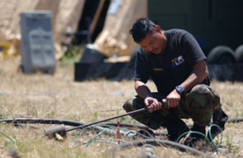 Tech. Sgt. Reynaldo Gumarang, a KC-135 Stratotanker Boom Operator from the 452nd Air Lift Control Flight, sets up communications at San Clemente Island, Calif. Sergeant Gumarang was participating in Patriot Hook 2007, a joint services exercise led by the Air Force Reserve Command. U.S. Air Force photo by Staff Sgt. Mary D. Woolstenhulme