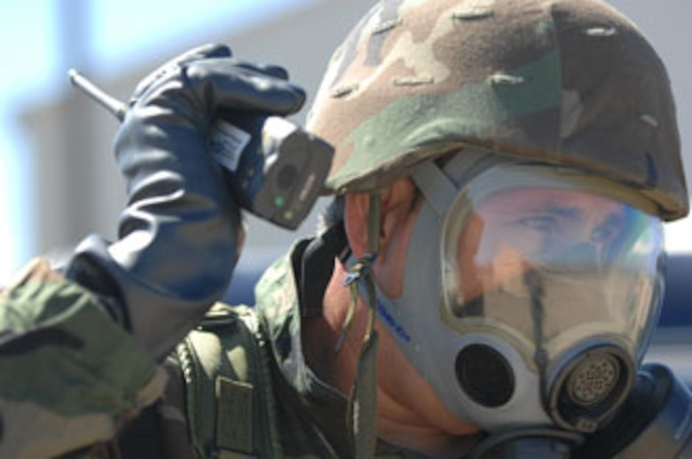 An Airman from March Air Reserve Base, Calif., calls in the location of an unexploded ordnance while at San Clemente Island, Calif., participating in exercise Patriot Hook 2007. U.S. Air Force photo by Staff Sgt. Francisco V. Govea II