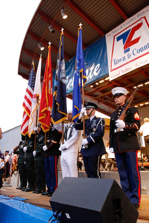 The Goodfellow Color Guard prepares to post the colors for the playing of the Star Spangled Banner at the Pops Concert July 3. (U.S. Air Force photo by Tech. Sgt. Sean Blumenhein)