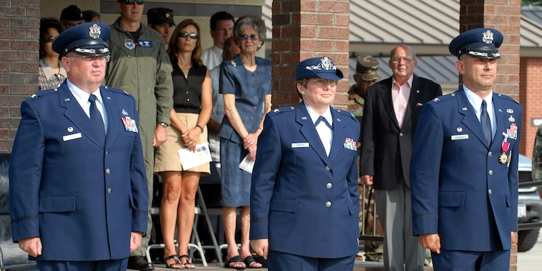 From left to right: Col. Richard Ayres, 17th Training Wing commander; Col. Ada Conlan, 17th Mission Support Group commander, and Col. Stephen Czerwinski, former 17 MSG commander, stand at attention for the playing of the Air Force Song during the 17 MSG Change of Command ceremony Tuesday. (U.S. Air Force photo by Tech. Sgt. Gina O'Bryan)