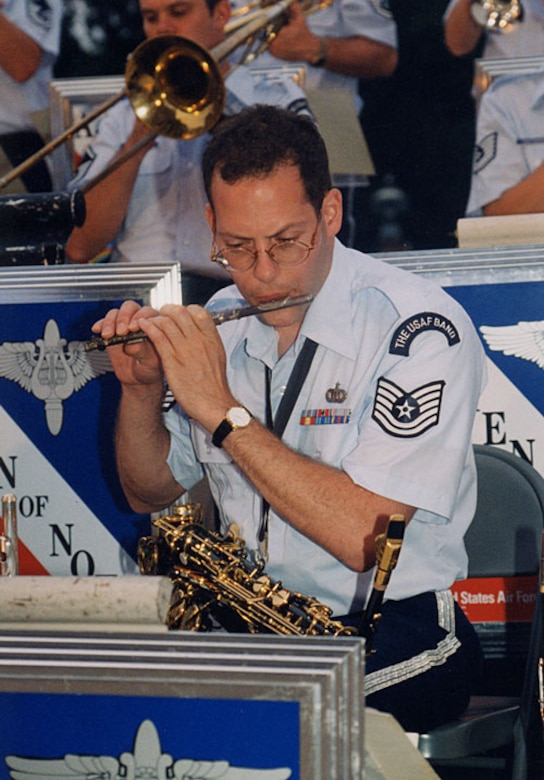 Jazz Alto saxophonist, Tech. Sgt. Andy Axelrad of the Airmen of Note, doubles on the piccolo and clarinet for the section. Photo Credit: Official U.S. Air Force Photo