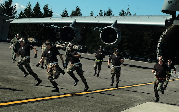 Members of the Patriot Wing?s aerial port Air Mobility Rodeo team participate in the C-5 engines running offload (ERO) competition at McChord Air Force Base, Wash. The Westover team won first place for the best C-5 ERO team in the Air Force. (U.S. Air Force photo/Tech Sgt. Andrew Biscoe)