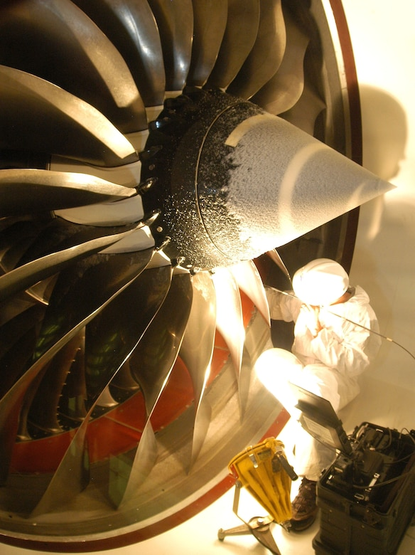 An engineer checks the condition of a Trent 100 engine during testing. The test looked at the engine in icing conditions at altitude for FAA (Federal Aviation Administration) compliance, Icing certification testing at simulated altitude conditions is a capability unique to AEDC, especially for high airflow engines like the Trent 1000.