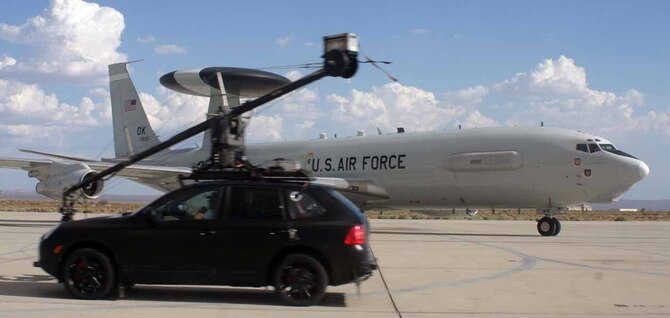 """An E-3 Sentry gets its own close-up as a film truck drives around it, gathering footage for """"Transformers: The Movie"""" at Edwards Air Force Base, Calif., during the film production last year. (Air Force photo by Capt. Corinna Jones)"""