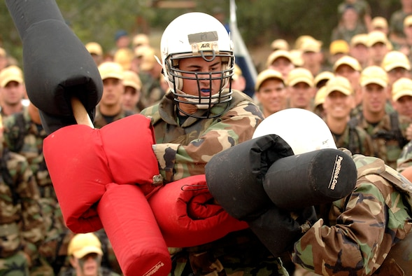 """Academy basic cadet trainees Griffin Biscone (left) and Lawrance Franklin battle it out July 28 at the U.S. Air Force Academy, Colo., for the title of """"Big Bad Basic,"""" a single-elimination tournament where cadets battle one another with pugil sticks. Cadet Biscone went on to win the title in front of 1,200 of his peers. (U.S. Air Force photo/Mike Kaplan)"""