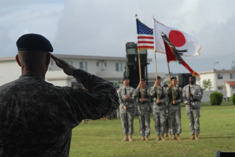 Army Brig. Gen. Roger Mathews salutes during the playing of the U.S. and Japan national anthems during the assumption command for the 1-1 Air Defense Artillery Battalion at Kadena Air Base, Japan, Aug. 7, 2007.  Army Lt. Col. Edward O'Neill assumed command of the 600-person battalion.  The unit activated at the base in November 2006, conducts missile defense for the region with the Patriot missile system in accordance with the U.S. and Japan bilateral security agreements. General Mathews is the 94th Air and Missile Defense Command commander at Fort Shafter, Hawaii. U.S. Air Force photo/Senior Airman Darnell Cannady